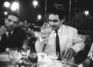 Roma, 1960. Lo scrittore e regista Pier Paolo Pasolini con Italo Calvino al Caffe' Rosati in piazza del Popolo