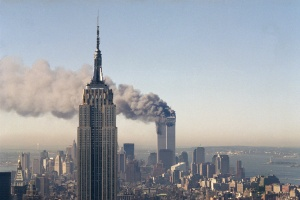 Sept. 11, 2001, file photo, the twin towers of the World Trade Center burn behind the Empire State Building in New York. The twin towers stood as New York's tallest from 1972 until the terrorist attacks of Sept. 11, 2001, when two planes crashed into the World Trade Center causing the twin 110-story towers to collapse, making the Empire State Building the tallest once again.